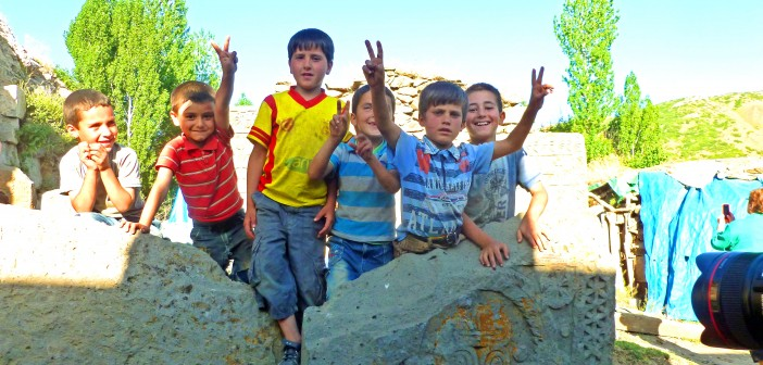 """Kurdish children atop a Khatchkar at St. Garabed Monastary. Armenian population: 0. Taken: Summer 2014 by Fr. Vazken Movsesian"""